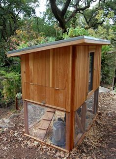 chicken coop with succulents on the roof.