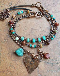 Pretty multi-strand neckalce with a hammered heart pendant #handmade #jewelry #beading