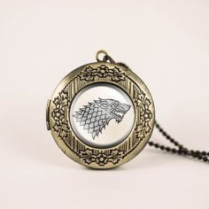 Game of thrones house Stark crest vintage pendant locket necklace - ready for gifting - buy 3 get 4th one free on Etsy, $17.00