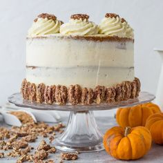 Pumpkin spice layer cake with mascarpone cream and spiced sugared pecans; perfect for any Autumn celebration!