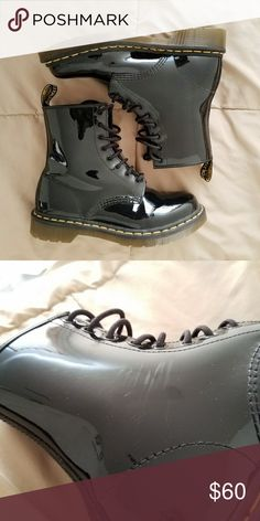 Dr. Martens 1460 Women's Boots Black combat boots. They are real leather with a glossy finish. I have only worn them twice. For the most part they look pretty much new, the leather in certain spots has creased due to being partially broken in from wear. In addition, on the left boot, facing inwards, there are faint scratches between the laces and the ankle. The same goes for the right boot, but is hardly noticeable. Dr. Martens Shoes Combat & Moto Boots