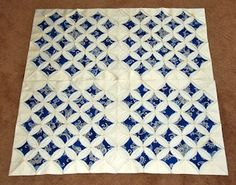 My Cathedral Window quilt in progress showcased on Gallery of Quilts