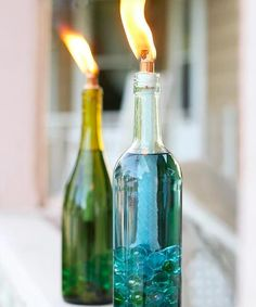 Replace your old, weathered tiki torches with beautiful, colorful DIY wine bottle citronella candles. Replace your old, weathered tiki torches with beautiful, colorful DIY wine bottle citronella candles. Reuse Wine Bottles, Wine Bottle Art, Wine Bottle Crafts, Bottles And Jars, Diy Bottle, Empty Bottles, Bottle Garden, Wine Corks, Recycled Bottles