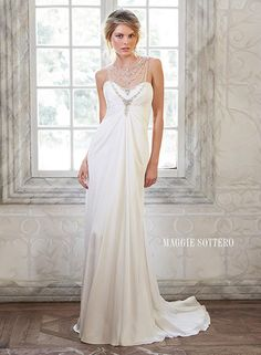 Maggie Sottero wedding gown. Stunning Swarovski crystals are draped across an illusion neckline and back.