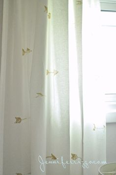 Handstamped curtains--arrows with fabric paint. DIY this with black arrows