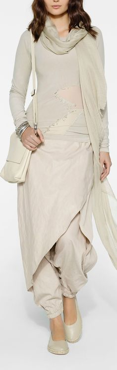 Lovely milky outfit by Sarah Pacini. Pants with a drape, pullover with a transparent detail, cross body bag and shiny scarf