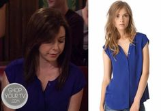 Lily Aldrin (Alyson Hannigan) wears this cap-sleeve 100% silk blue top in this week's episode of How I Met Your Mother.
