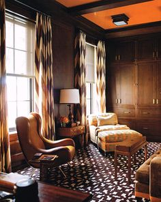 Steven Gambrel Formal Living Rooms with dark colour scheme. Note wall panelling, geometric carpet, geometric curtain fabric & ochre ceiling.