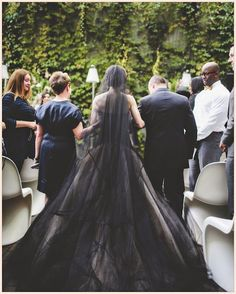 Black wedding dress with white veil
