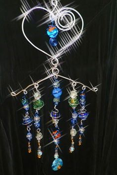 Wind chime, sun catcher wire wrapped marbles