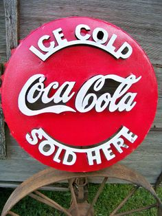 22in across. from recycled metal. Rustic Metal Coca Cola Bottle Cap Sign ~ Welded Metal Art Advertising Soda Décor. Probably new, no mention of age at all.
