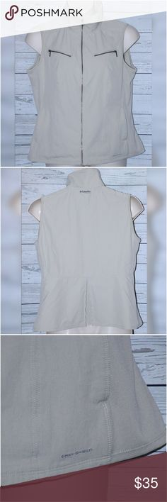 """Columbia Women Sz XL Beige Titanium Omni Vest Columbia Women Sz XL Beige Titanium Omni Shield Hiking Fishing Multi Pocket Vest Stretch Sides  All measurements are approximate and  taken unstretched and laying flat.   Chest: 42""""  Length: 23.5""""   EUC no rips or stains   If you have any questions, please don't  hesitate to send me a message.  Please feel free to check out the other  items listed in my store.   Note to Buyers:  **Colors may vary slightly from photos of item, due to lighting…"""