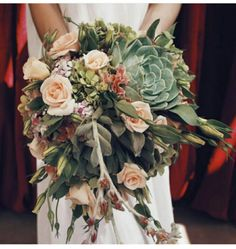 A bridal bouquet with succulents, roses and hydrangeas ...