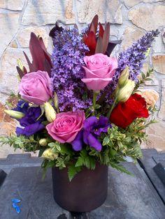 Contemporary Arrangement, Lavender Roses, Red Roses, Purple Lisianthus, Leucadendrom and more