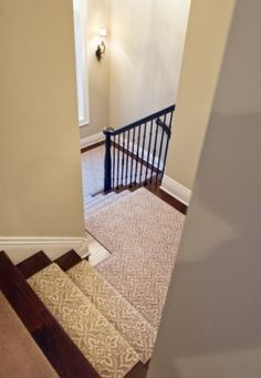 transitioning patterned stair runner to solid carpet or wood floors upstairs. Minnewashta lake home...Houzz. Stanton + Rose Core carpet, Cape May in Pearl.