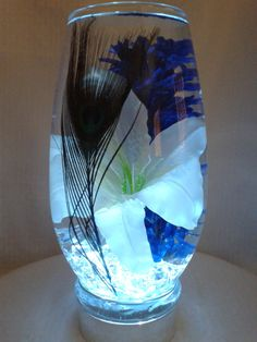 An elegant single peacock feather displayed by WreathsByDiane, $40.00