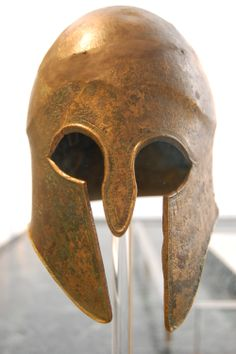 A Bronze Corinthian Helmet Seeing this piece of war reminded me of the many waring nations within modern day Greece. I couldnt stop but wonder if this man the helmet belonged to, sat on his head during the many long marches and through the battles...did he survive to old age? Olympia Museum Greece ©photo by jadoretotravel