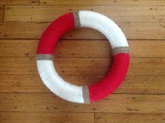 Yarn wrapped around a foam wreath. Cute nautical decor for my nautical classroom