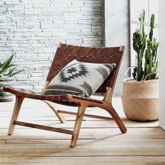 Our low, woven leather chair makes lounging an inescapable temptation. Leather straps in a rich caramel color are woven onto a white cedar hardwood frame and secured with bronze rivets. Details - Made