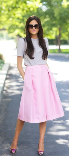 Rachel Parcell is wearing a pink full skirt from Tibi, top from ASTR, shoes from Kate Spade and sunglasses from Prada