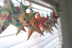 Paper stars garland, using the tutorial from http://www.homemade-gifts-made-easy.com/5-pointed-origami-star.html#COMMENTING.