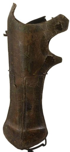 Ottoman leather quiver, second half 17th century, rectangular lobed-form stitched together with attachment straps secured by metal rivets with rosette terminals, 36cm.