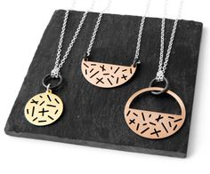 Necklaces from the Random Collection, random pattern of lines and stripes, in brass, bronze and silver by Camillette Jewelry