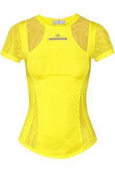 Bright-yellow stretch-polyester Climacool® technology, sheer stretch-mesh panels, cutout back Slips on 80% polyester, 20% spandex; trim: 93% polyamide, 7% elastane Machine wash