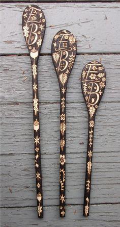Woodburned monogrammed spoons.