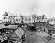 Biltmore Estate | May 8, 1894, about 1.5 years before the Christmas 1895 completion date requested by George Vanderbilt.  Visible in the center is the blacksmith shop, with its tall smokestack.  Directly behind the shop is a construction office, to its right is the masonry workshop of James Sinclair and Company.  Derricks for lifting heavy material were scattered across the job site.