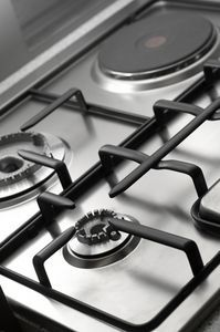 Tips on How to Clean a Gas Oven. Tried the baking soda, soap, vinegar cleaner and my oven is so much shinier!