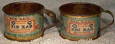 https://www.trocadero.com/stores/merday/items/1118106/Pair-ZIG-ZAG-CONFECTION-TIN-LITHOGRAPH-PREMIUM-MINIATURE-CUPS-1900