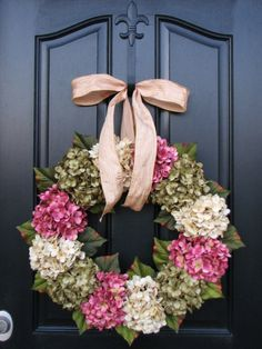 Spring Wreath for front door??  Love the fleur de lis hanger!