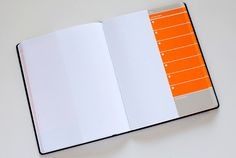 I know this won't make my life organized but it will make it look more designy.  There is a whole line of smart and simply designed action notebooks at Behance Outfitter