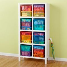 A book shelf with storage boxes makes any classroom a lot more organized.