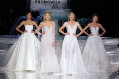 """Barcelona, das Mekka hochqualitativer Brautmoden-Couture. Denn, wenn die Hauptstadt Kataloniens zur Bridal Fashion Week ruft, folgen ihr sämtliche Prominente aus aller Welt. Eine Pflichtshow darunter ist wahrlich jene von PRONOVIAS – DER führenden Brautmodenfirma weltweit. Mehr als 2.000 Gäste wurden dazu in die """"Kathedrale"""" des Unternehmens geladen – dem Nationalen Kunstmuseum Katalonien (MNAC) in Barcelona, …"""