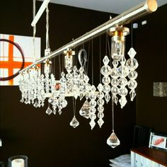 DIY chandelier from IKEA... Just hang buckets of crystals from fishing wire for a neater look