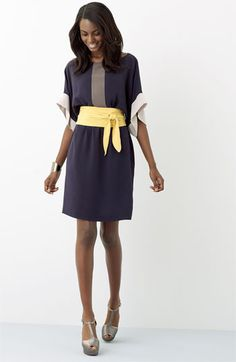 Love the wide yellow belt and gray toned dress