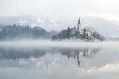 Bled on a foggy morning by Erik Meylemans. Bled is known for the glacial Lake Bled, which makes it a major tourist attraction. Perched on a rock overlooking the lake is the iconic Bled Castle. Slovenia