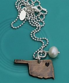 "Oh my gosh, YES! I love these! ""I love my state"" necklaces by The Vintage Pearl www.thevintagepearl.com"