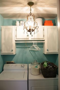 I'd much prefer cabinets in mine than those wire shelfs! Another job for my home improvement guy!
