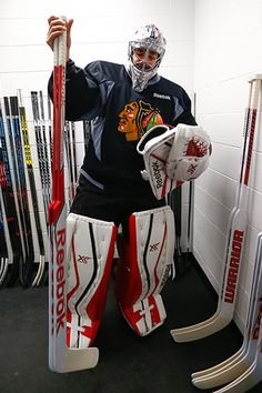 Corey Crawford finds his sticks before heading to the ice at Amalie Arena. #StanleyCup