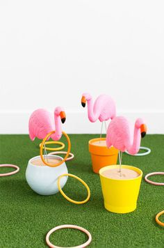 Complete your summer pool party birthday bash with a DIY flamingo ring toss lawn game.