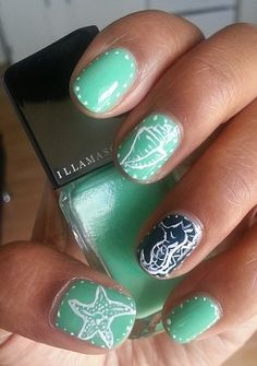 Let the beach inspire you with these seafoam green nails.