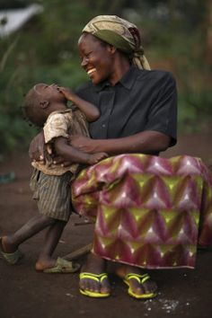 Protect women, mothers, and their children. Sister Angelique Namaika, a member of the Augustine Sisters of Dungu and Doruma, embraces a Congolese child at a site for internally displaced people Aug. 1 in Congo.