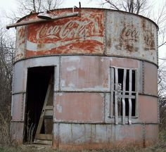 """""""Abandoned Oklahoma Oil Tank Soda Stand"""" -- [This round coca-cola building is located east of I-35 on SW 44th Street - Oklahoma City, Oklahoma. This oil tank at one point served as a soda stand.]~[Photograph by tikitonite - February 5 2012]'h4d-282.2013'"""