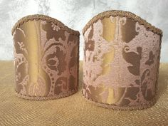 Couple of lampshades decorated with operato jacquard textured fabric with patchwork of textile fragments patterns, finished with antique Gold precious trim. 54,00 €