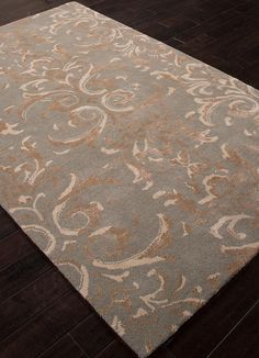 This hand-tufted rug illustrates lux patterns and details inspired by classic themes from around the world.  Timeless, by Jennifer Adams blends eternal traditions with today's lifestyles. Vintage and livable with comfortable elegance, this transitional rug is suitable for any décor. Shown here in Abby Stone and Tidal Stone.
