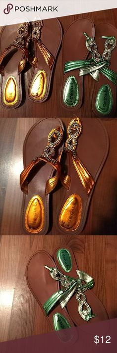Bundle of two sandals They are really cute ,and in  used condition. They still have many more miles on them. First pair is orange with bling, and other pair is  a green color with bling. Shoes Sandals