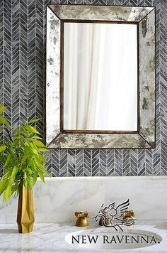 Chevron, a handmade mosaic shown in polished Greystoke,